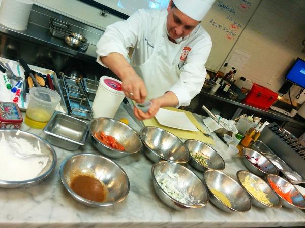 Chef Nic assembles a salad